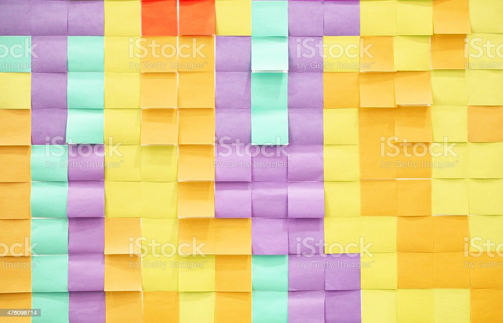 Many blank adhesive notes hang on the wall stock photo