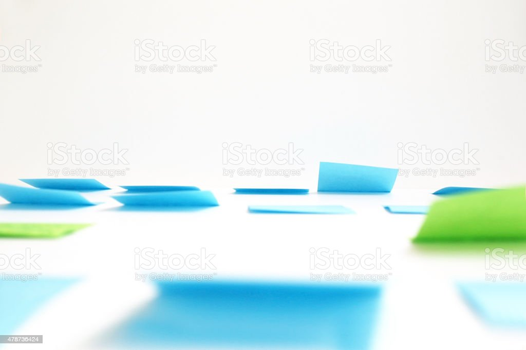 Many blank adhesive notes hang on the wall stock photo