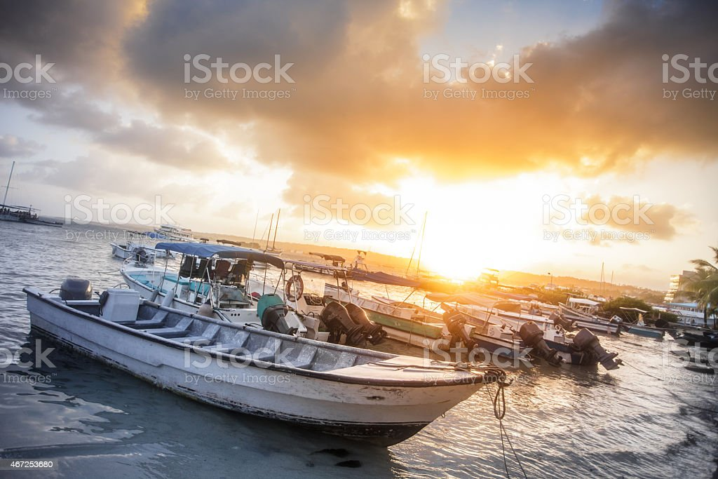 Many Boats on the Beach during Sunset. stock photo