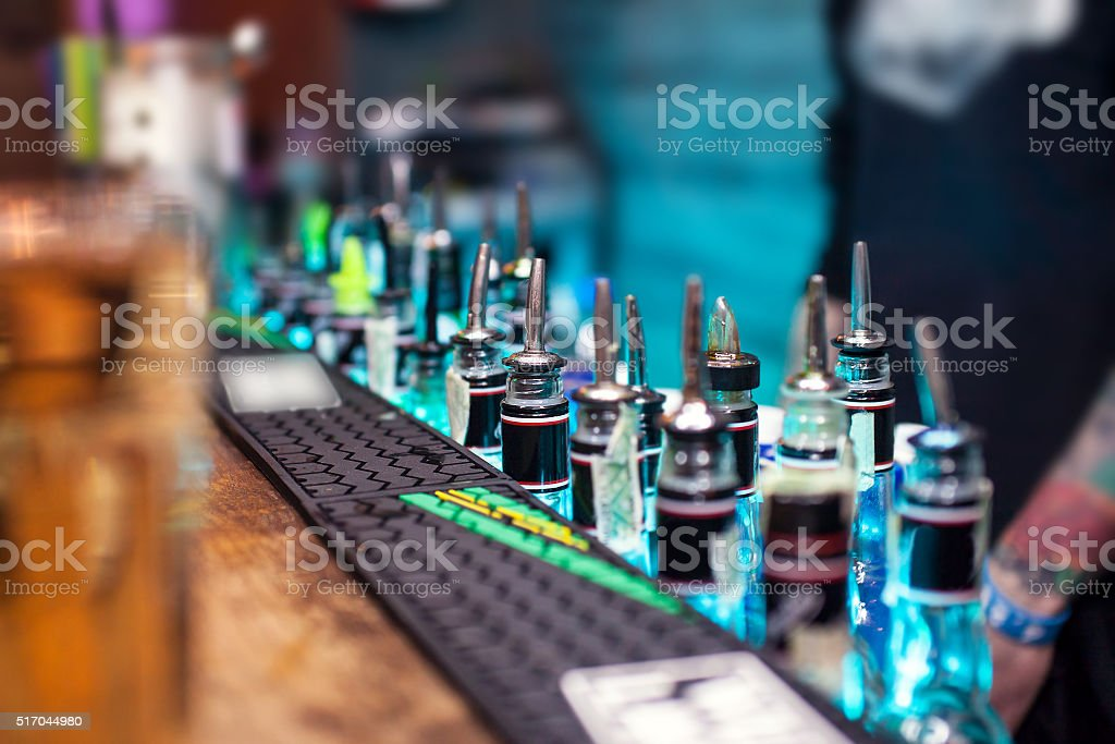 Many bottles with alcoholic beverages on the bar counter stock photo