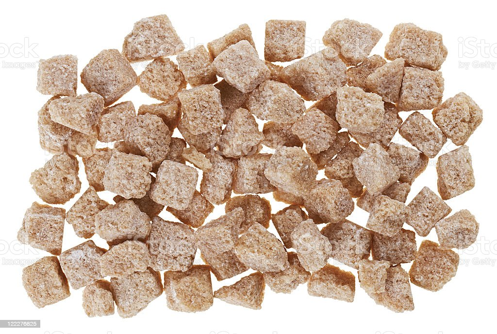 Many brown lump cane sugar cubes isolated on white royalty-free stock photo