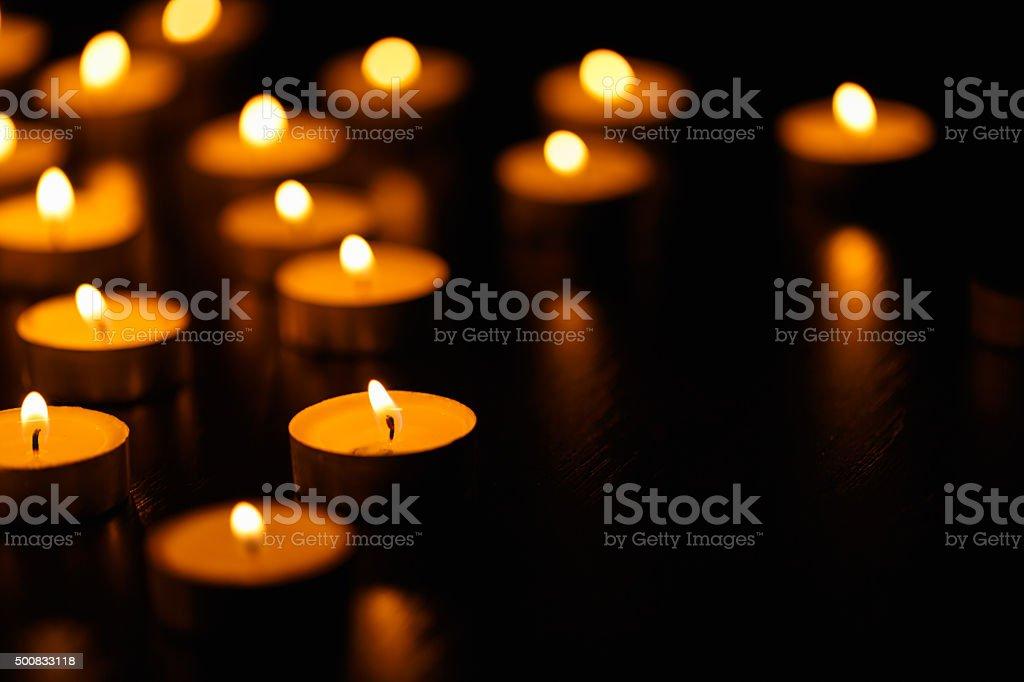 Many burning candles stock photo