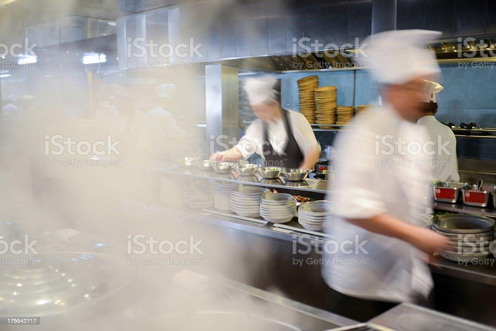 Many Busy Chefs Working In Kitchen - XXXLarge stock photo