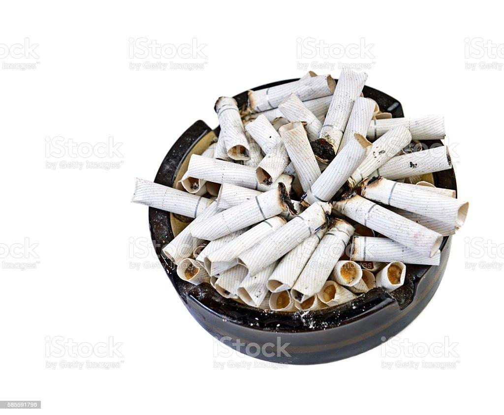 many butts in ashtray stock photo