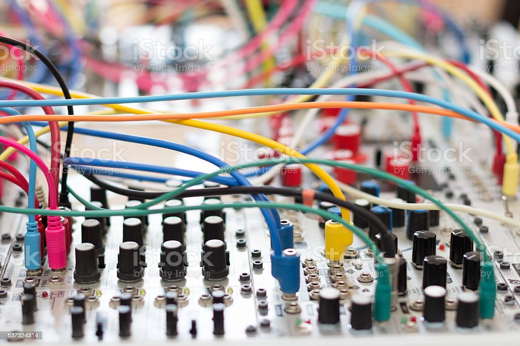 many cables connected on analog synthesizer - modular stock photo