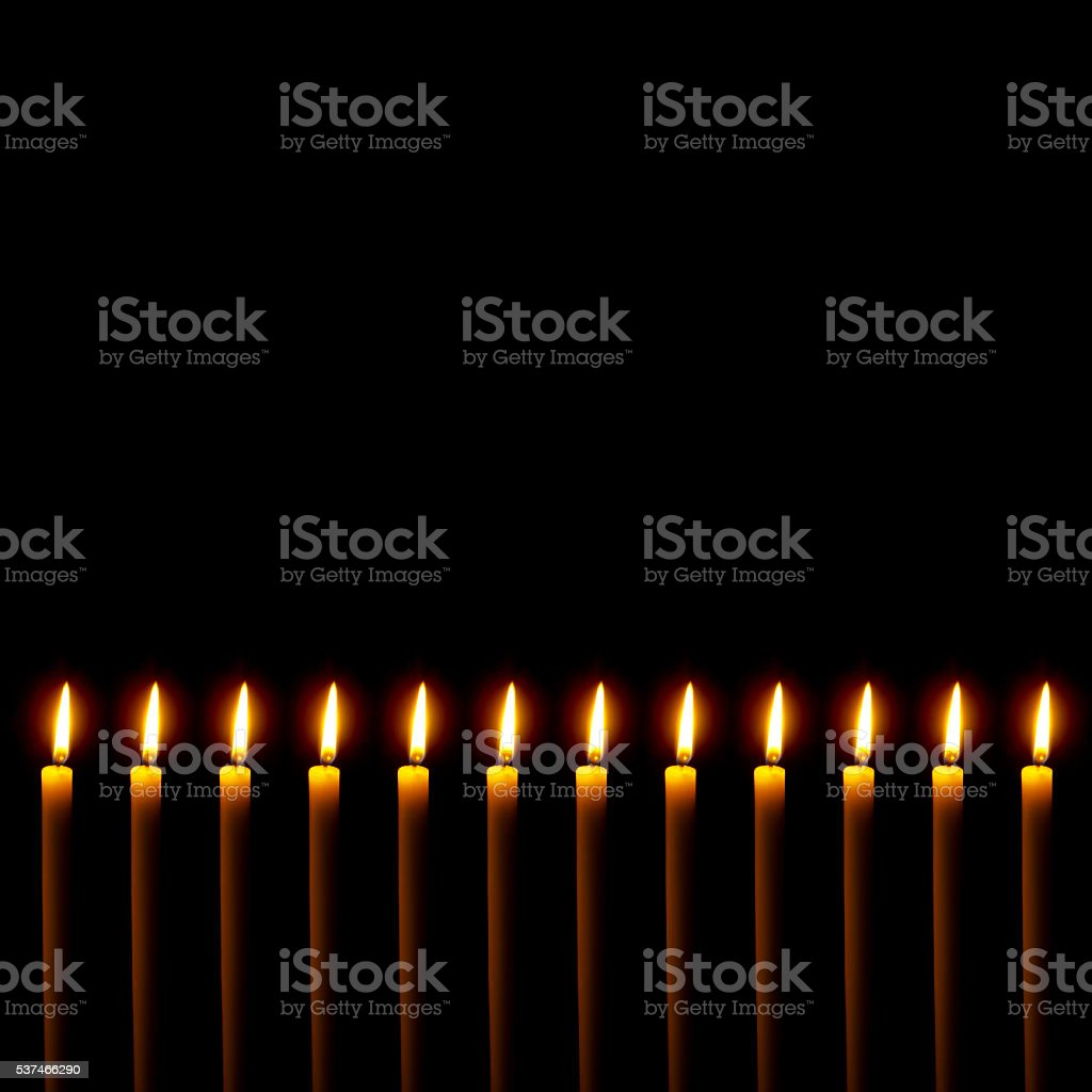 Many candles border on black. With copy space. stock photo