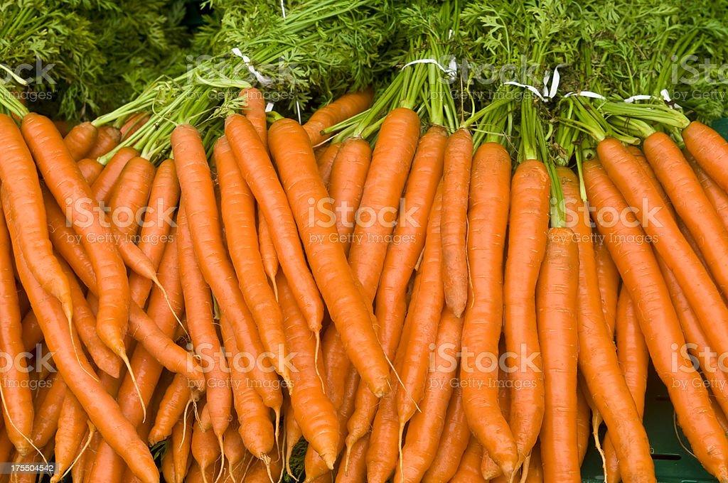 Many carrots at a market stock photo