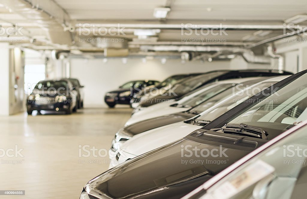 Many cars in parking lot or garage. stock photo