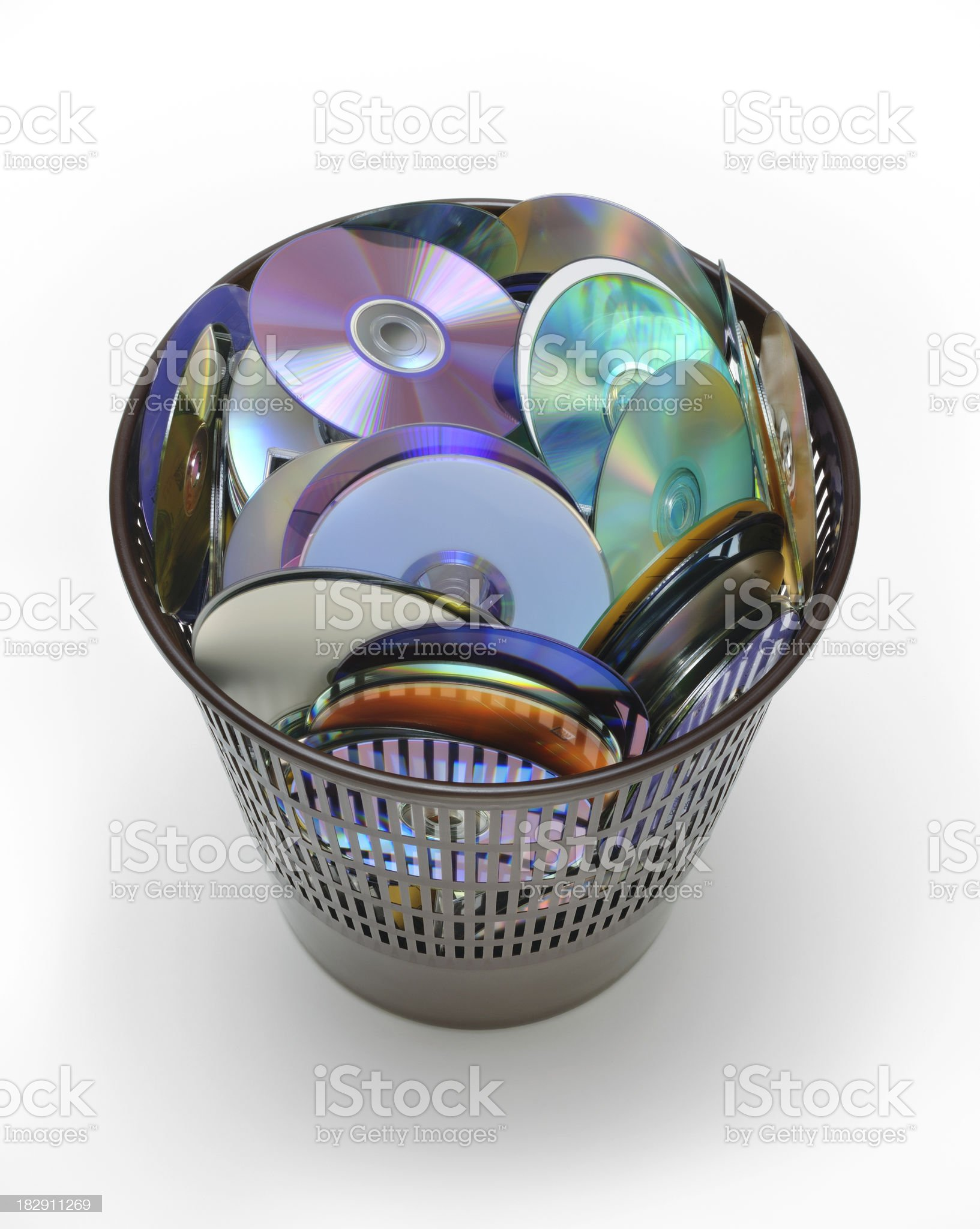 Many cd and dvd inside a basket on white background royalty-free stock photo