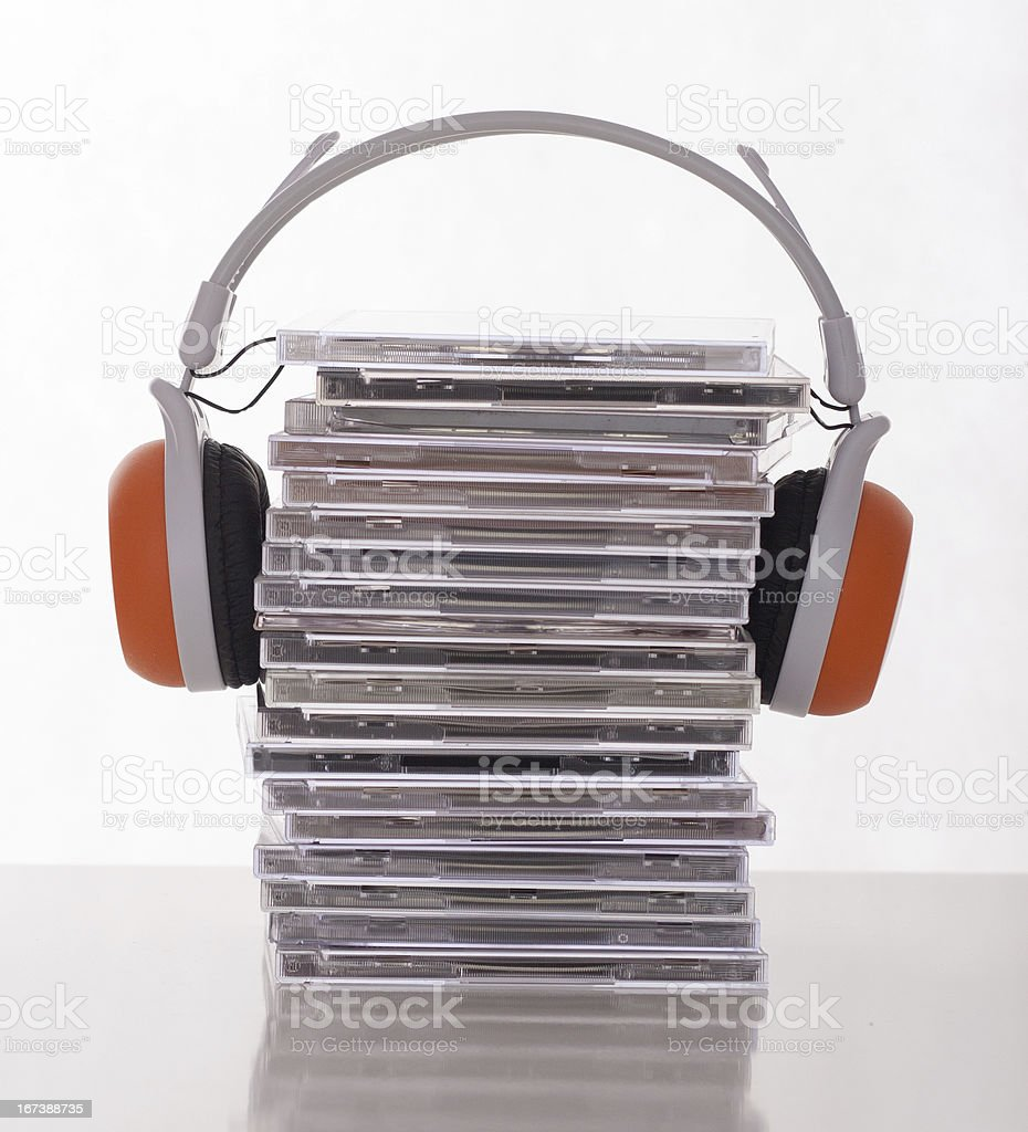 Many CDs with headphones royalty-free stock photo