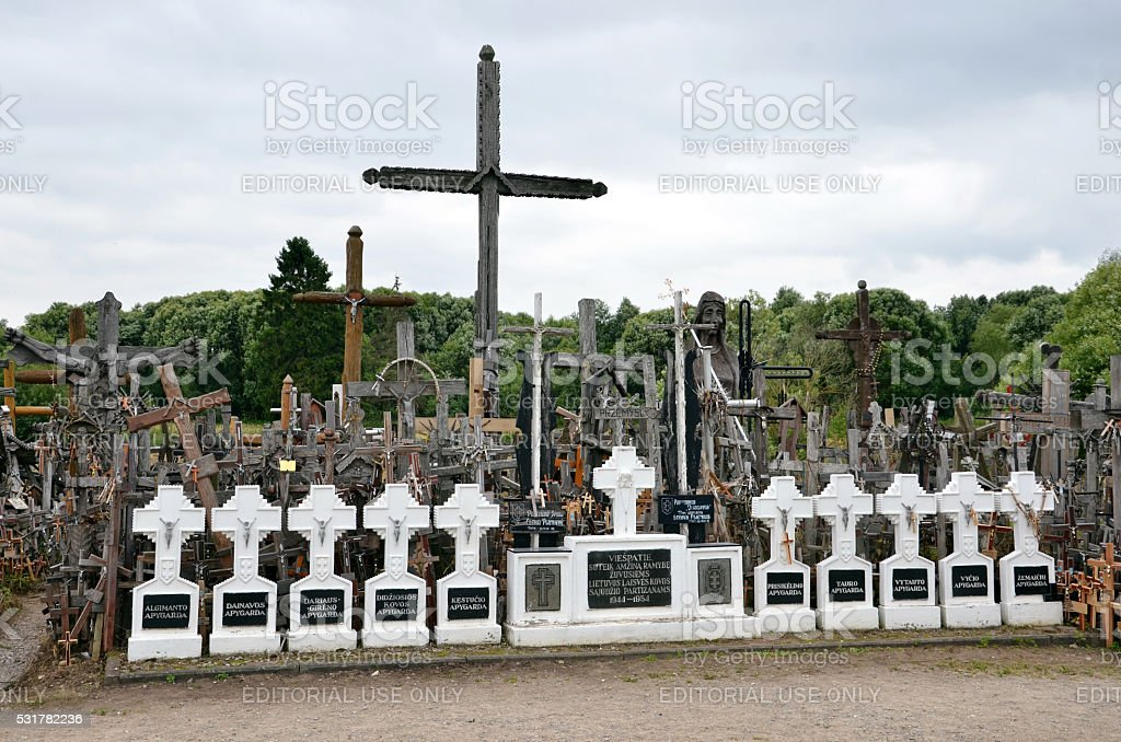Many christian crosses standing outdoor on the ground stock photo