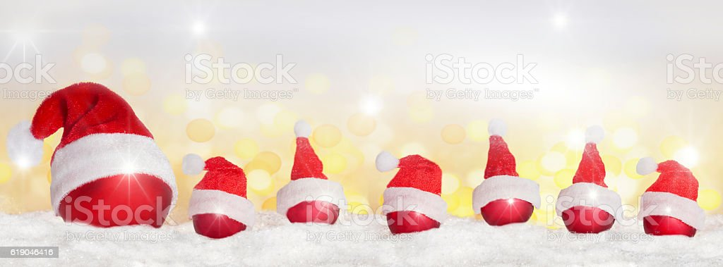 Many Christmas tree balls with Christmas hat stock photo