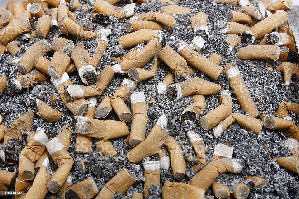 Many cigarette smoked in the crowd of royalty-free stock photo
