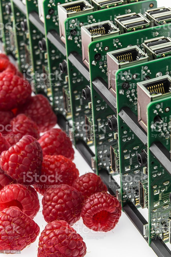 many circuit boards and several raspberries stock photo