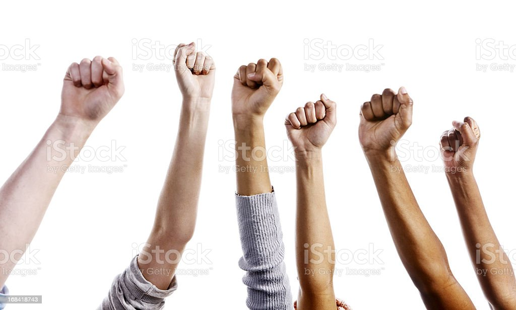 Many clenched fists raised against white background stock photo