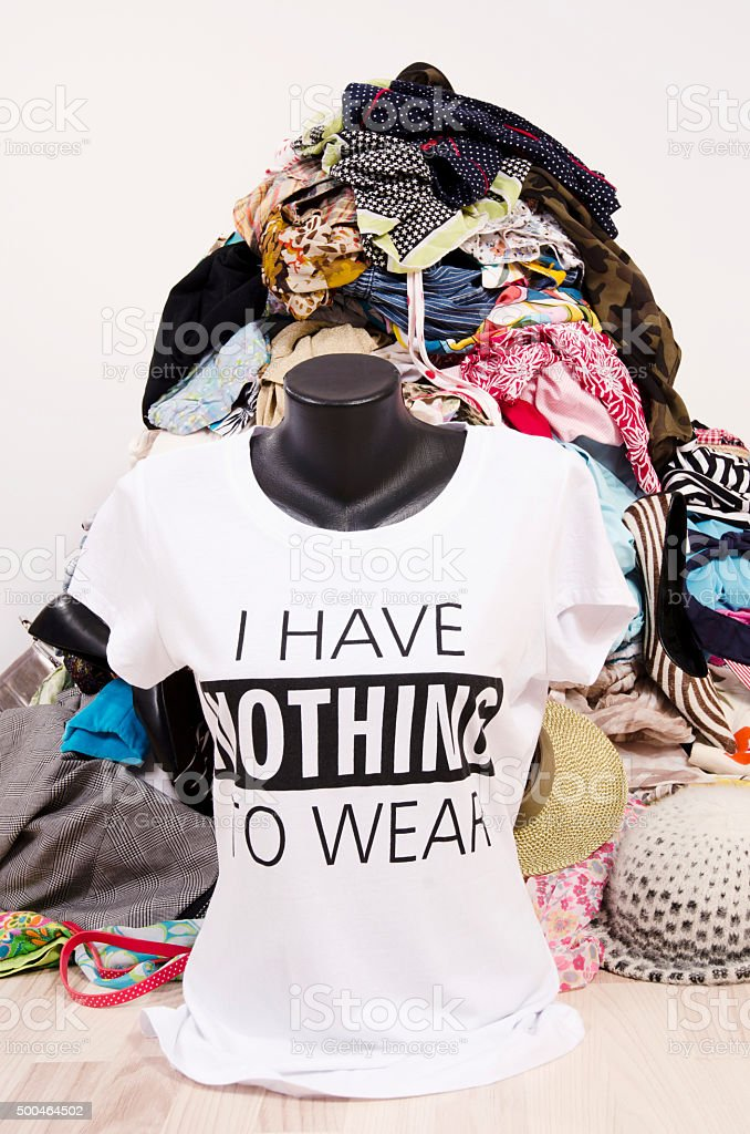 Many clothes and nothing to wear top on a mannequin. stock photo