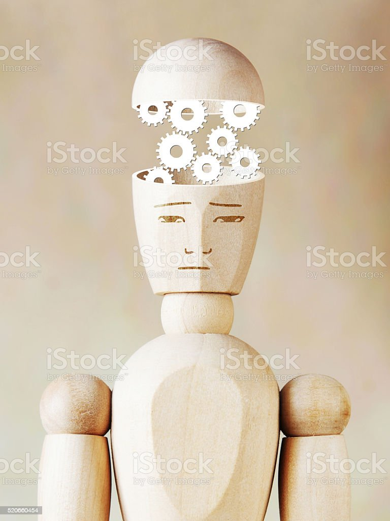 Many cogwheels working into the human head stock photo