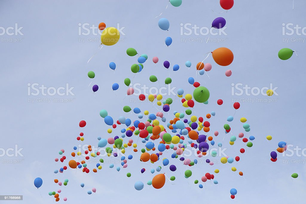 Many colored balloons fly into sky royalty-free stock photo