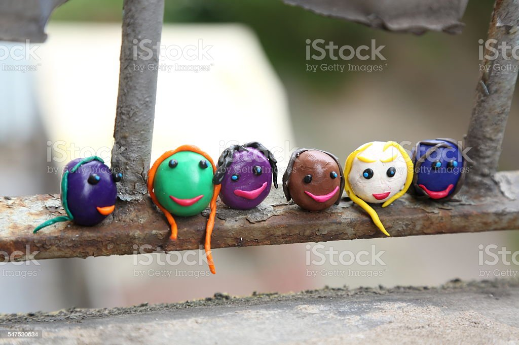many colored faces symbolizing national differences stock photo