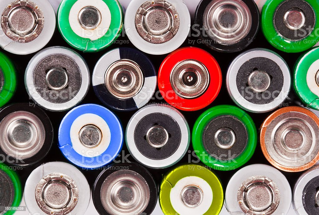 Many colorful batteries stock photo