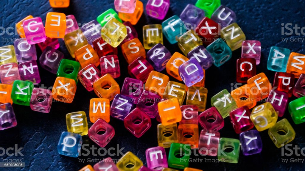 Many colorful decorative cubes with letter stock photo