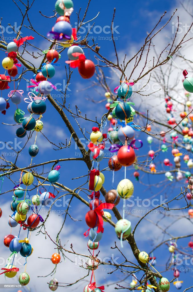 Many Colorful Easter Eggs On the tree. stock photo