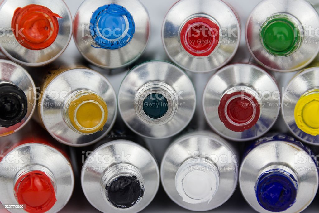 many colorful paint tubes closeup stock photo
