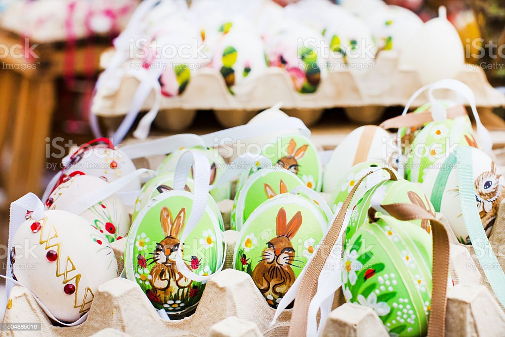 Many Colorful painted Easter eggs at traditional European market stock photo