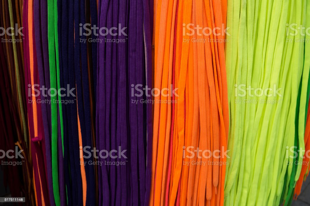 Many colorful shoestrings stock photo