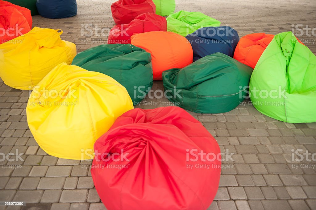 many colorful soft beanbag seats stock photo