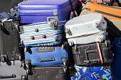 many colorful suitcases on a pile