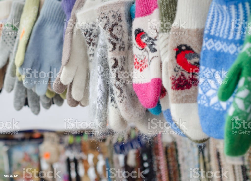 Many colorful winter gloves and mittens stock photo