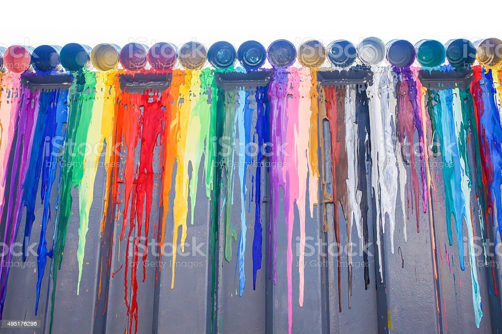 Many colours splash dripping and spilling for wall background stock photo