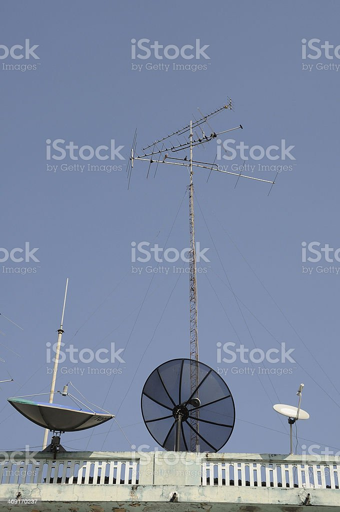 Many communications tools on top of building stock photo