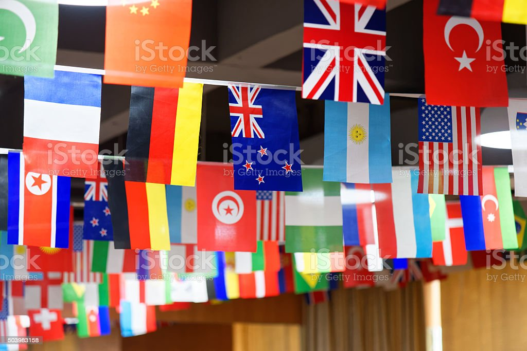 Many countries flags on a rope stock photo
