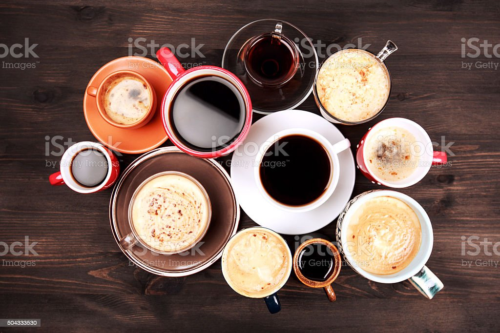 Many cups of coffee on wooden table stock photo