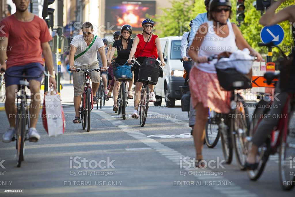 Many cyclists in busy traffic stock photo