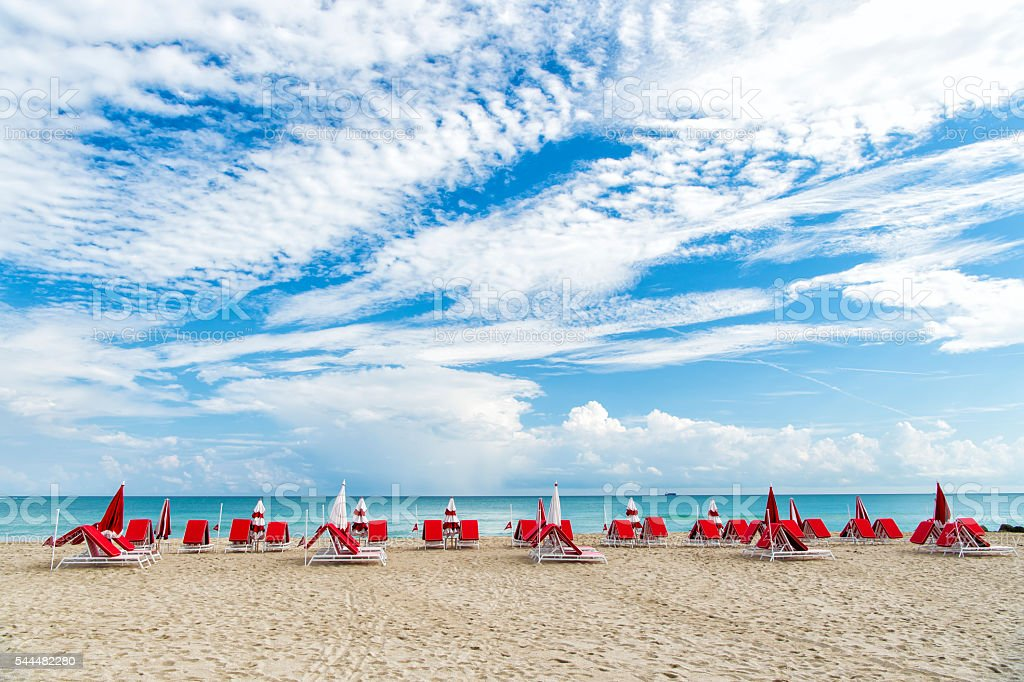 Many deck chairs in South beach stock photo