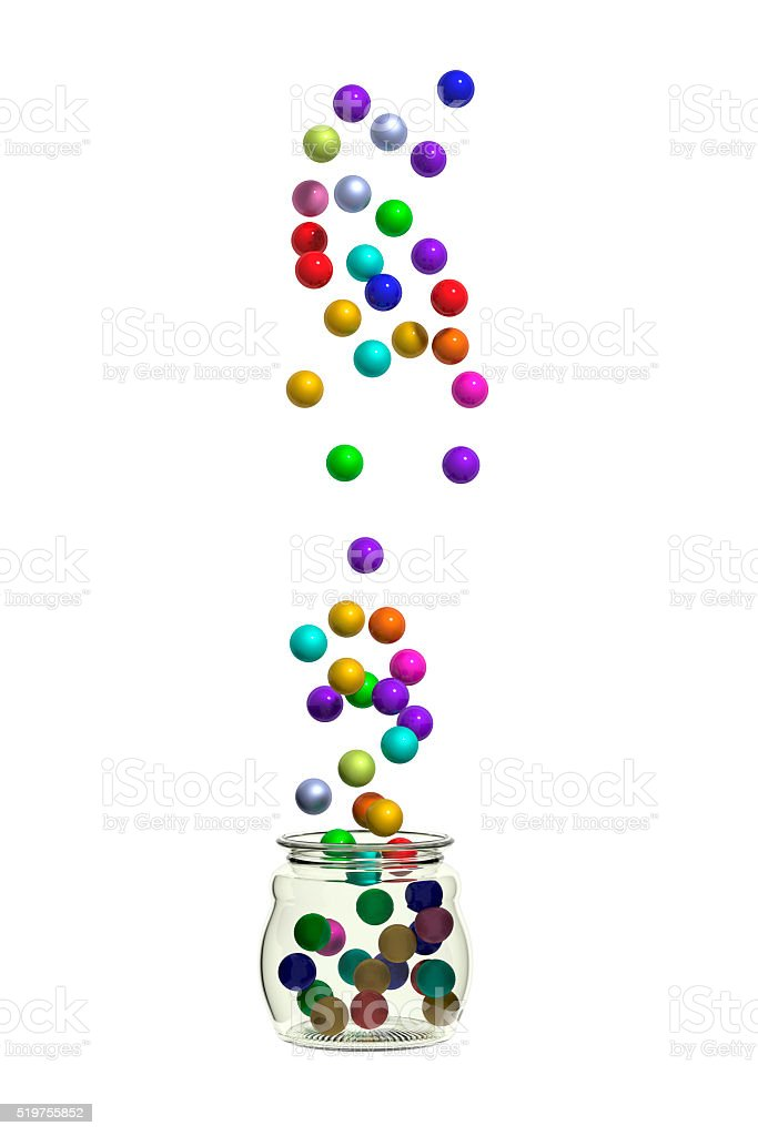 Many decorative balls falling into jar stock photo