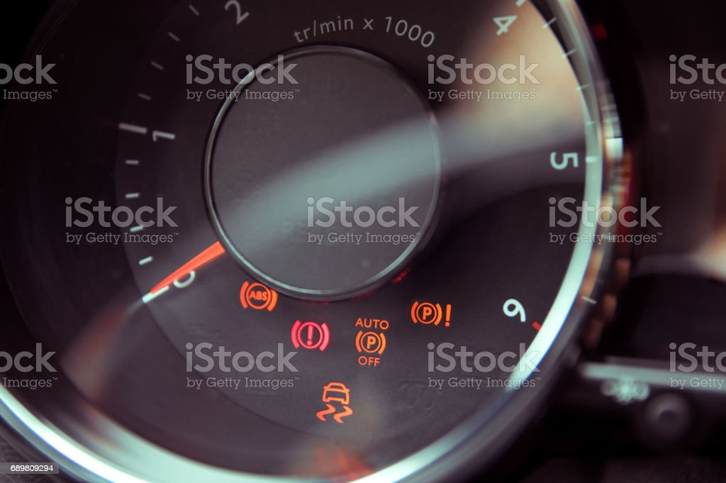 Many different car dashboard lights in closeup stock photo