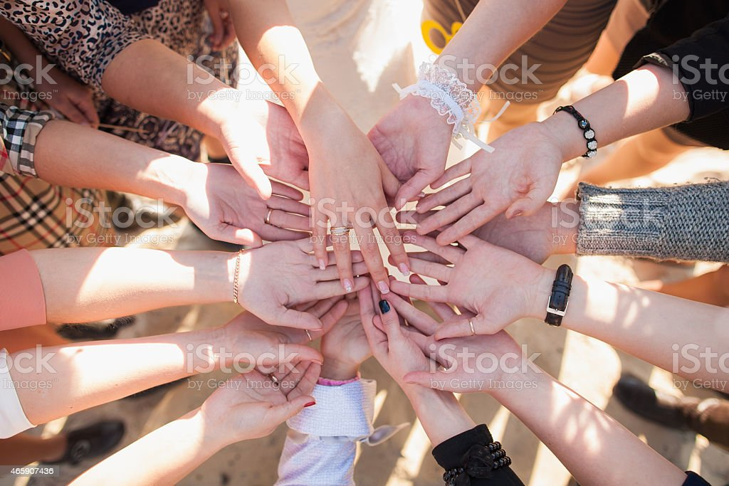 many different females hands with gold rings stock photo
