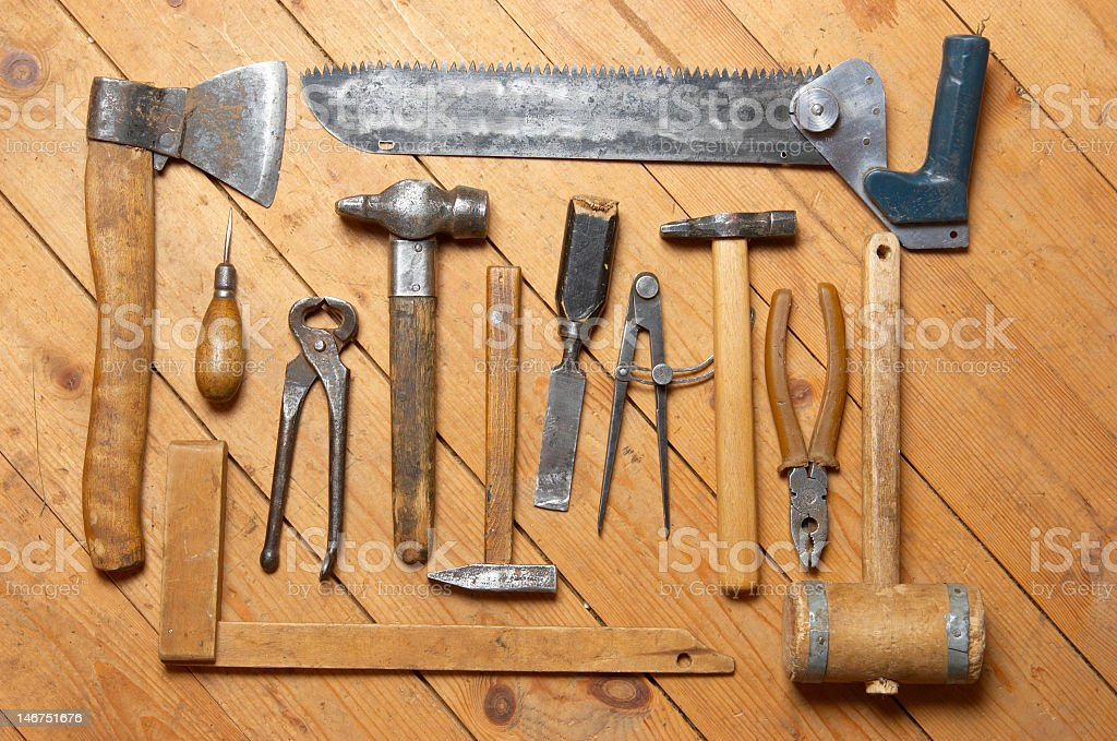 Many different old tools on a wooden surface royalty-free stock photo