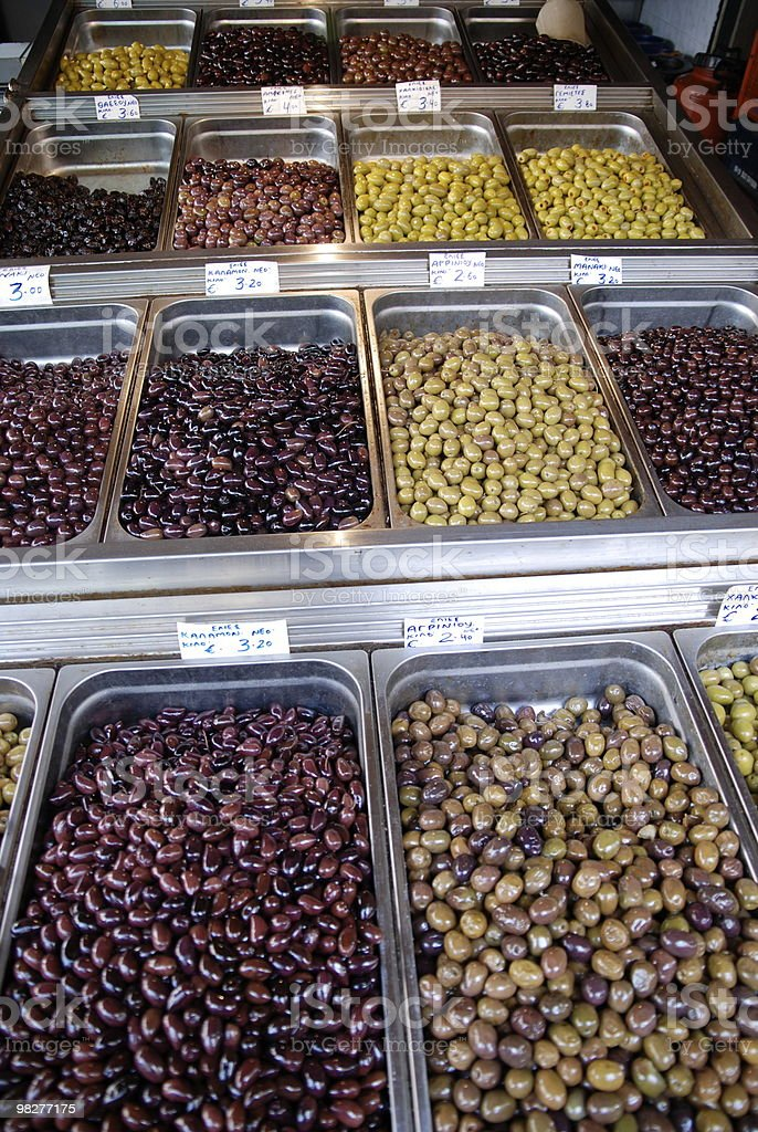 many different olives on a greek market stock photo