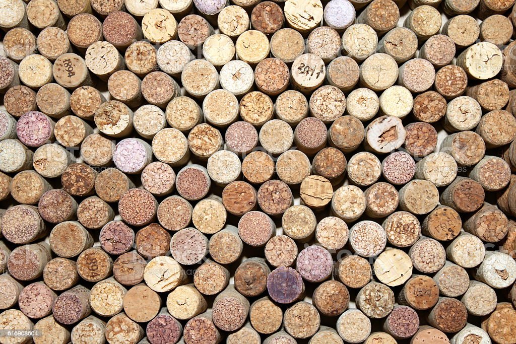many different used wine corks in the background stock photo