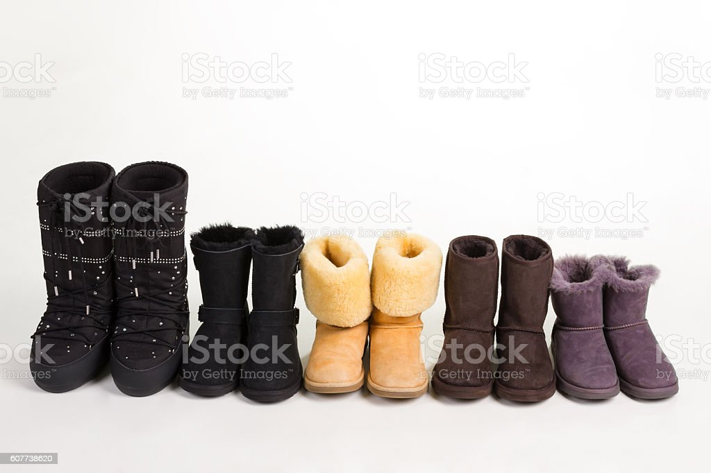 Many different winter boots on a white background. stock photo