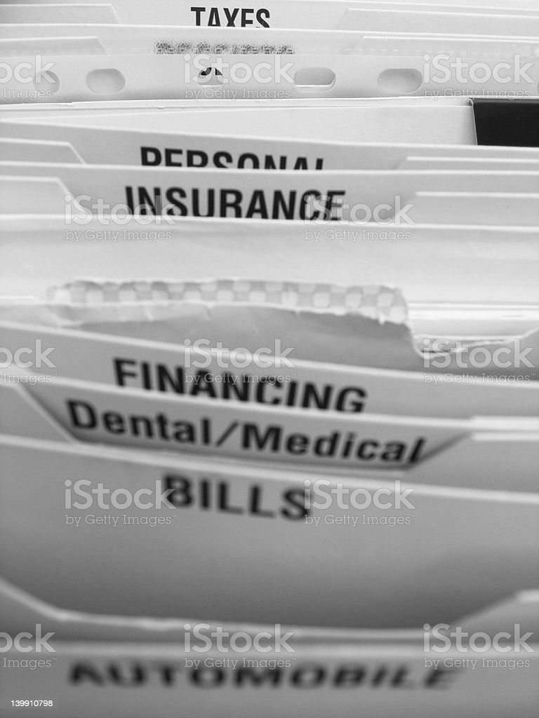 Many documents and bills in a file cabinet royalty-free stock photo
