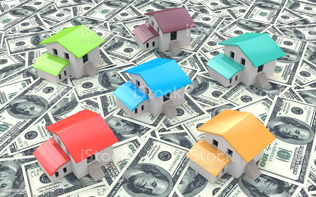 Many dollar banknotes and models of houses, concept of buying stock photo