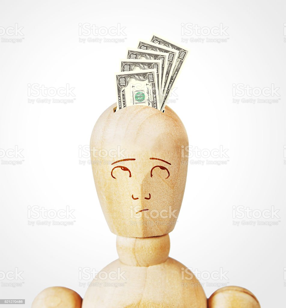 Many dollar banknotes are inserted into a human head stock photo