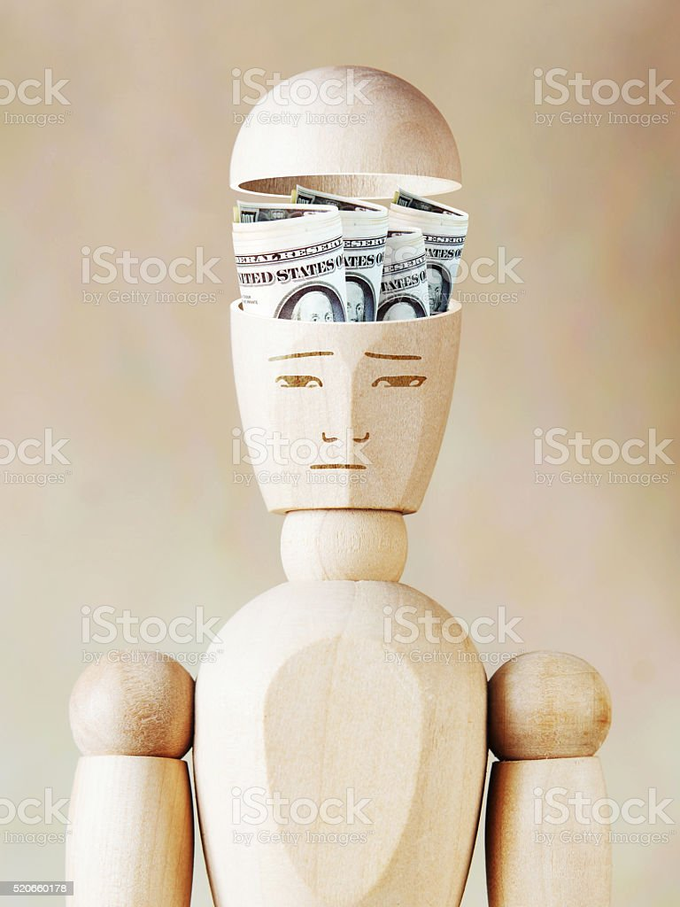 Many dollar banknotes lie in the human head stock photo