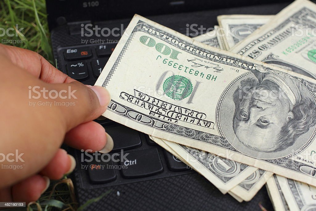 Many dollars banknotes and notebook stock photo